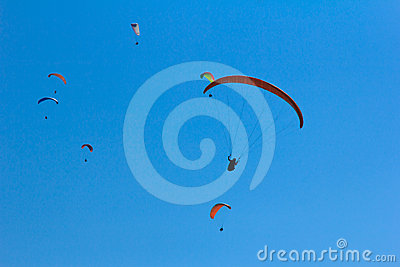 Paragliding under a blue sky in Nepal