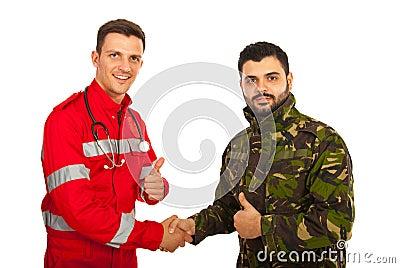 Paramedic and army man shaking