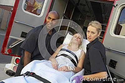 Paramedic preparing to unload patient