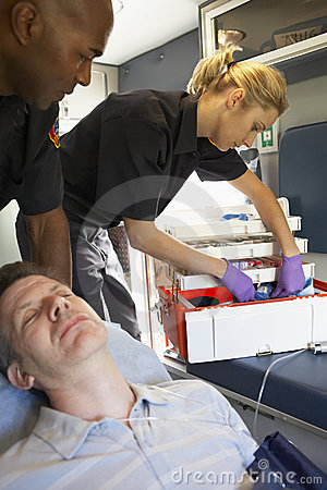 Paramedics with patient in ambulance