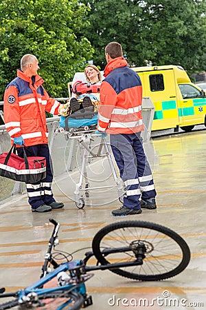 Paramedics with woman on stretcher ambulance aid