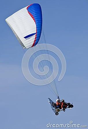 Paramotor glider in blue sky