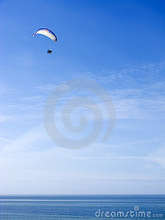 Paramotor glider over ocean