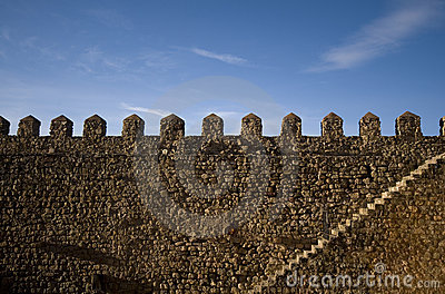 Parapet walk of a fortress. Stairway and merlons.