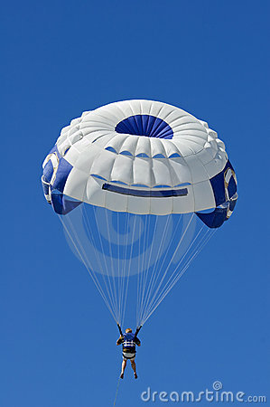 Parasailer Against Blue Sky Vertical