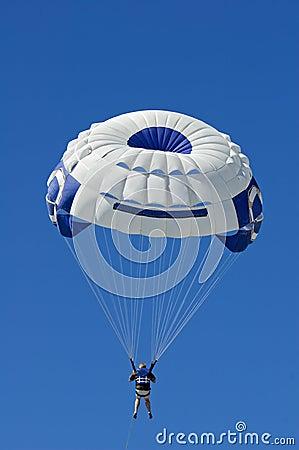 Parasailer Against Blue Sky Vertical