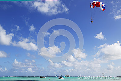 Parasailing in a blue sky in Punta Cana, Dominican Republic Editorial Photo