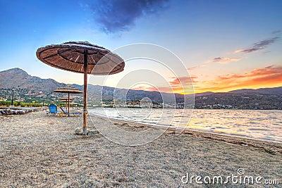 Parasol at Mirabello Bay at sunset