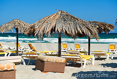 Parasols with deckchairs on the beach