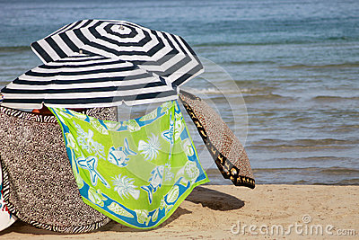 Parasols on sandy beach