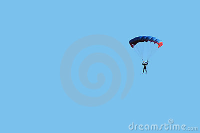 Paratrooper in blue sky
