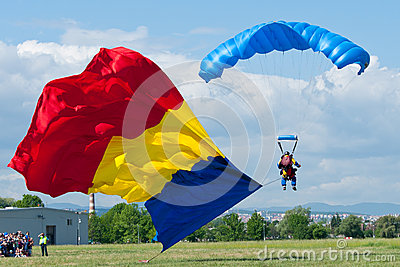 Paratrooper carrying the flag at the Romanian Air Show Editorial Photo