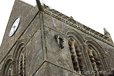 Paratrooper hangs on church