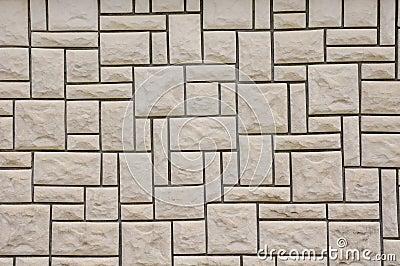 Pared alineada con las losas de piedra foto de archivo for Losas de pared