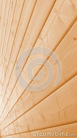 Pared de madera hecha de tablones largos