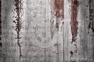 Pared Textured con las manchas de óxido rojas