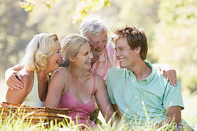 Parents with adult children on picnic