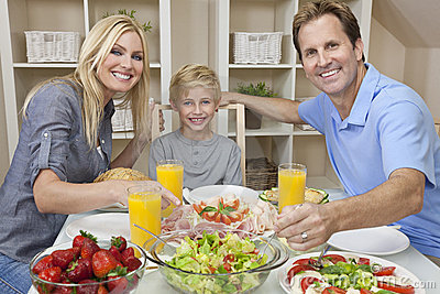 Parents Child Family Healthy Food At Dining Table