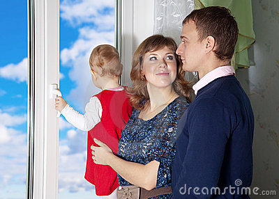 Parents with a child looking out the window