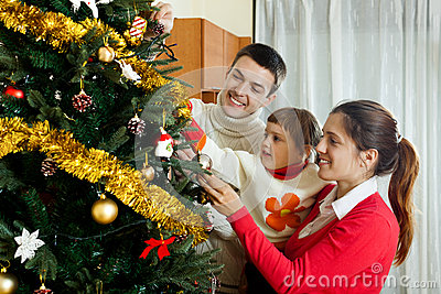 Parents and child preparing for Christmas