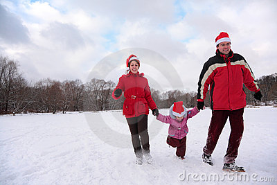 Parents with child run in park