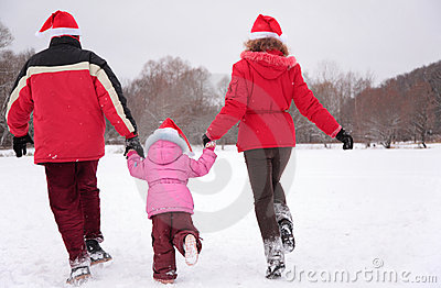 Parents with child run in winter from back