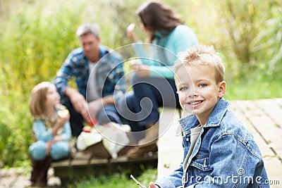 Parents And Children Having Picnic