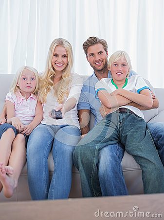 Parents and children watching TV