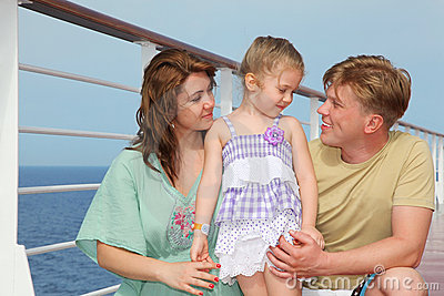 Parents with daughter enjoy sea on yacht