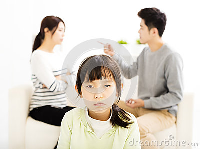Parents fighting and little girl being upset Stock Photo