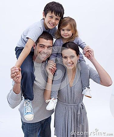 Free Parents Giving Children Piggyback Rides Stock Image - 11541881