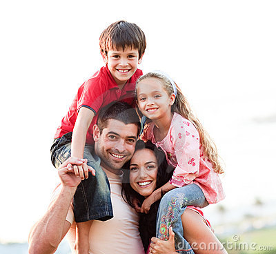 Free Parents Giving Children Piggyback Rides Royalty Free Stock Images - 9456419