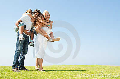 Parents giving piggyback rides