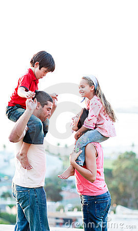 Parents giving their children piggyback rides