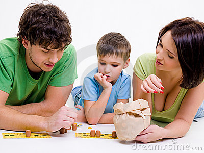 Parents indoors playing with little son