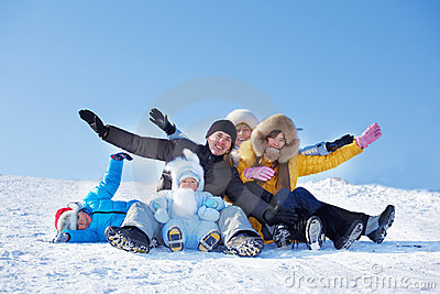 Parents And Kids On Snowy Hill Stock Photography - Image: 23087252