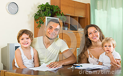 Parents and little daughters with documents Stock Photo