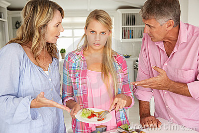 Parents making teenage daughter do chores at home