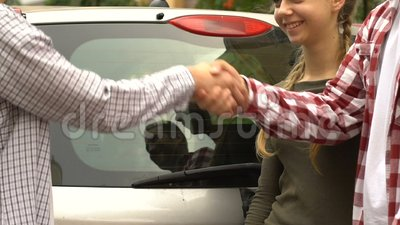 Parents Presenting Happy Teenage Son With New Car Long Awaited Birthday Gift Stock Video