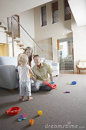 Parents And Son Playing With Toy
