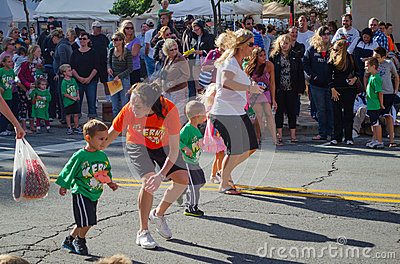 Kids runnning a race Editorial Stock Image
