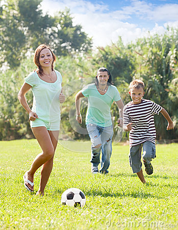 Free Parents With Teenager Son Playing With Soccer Ball Stock Photo - 33613370