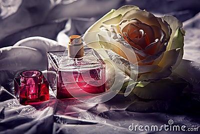 Parfume bottle with rose Stock Photo