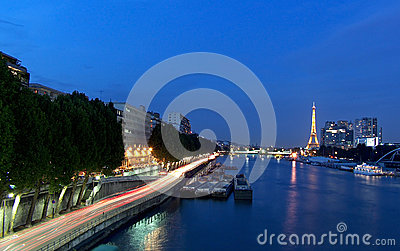 Paris - the Eiffel Tower seen from Pont de Garigliano at the blue hour Editorial Stock Image