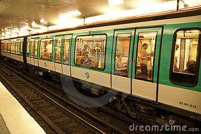 A Paris Metro train arrives at station Editorial Stock Image