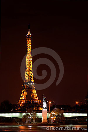Paris by night: Eiffel tower and Statue of Liberty Editorial Photography