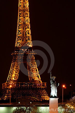 Paris by night: Eiffel tower and Statue of Liberty Editorial Stock Photo