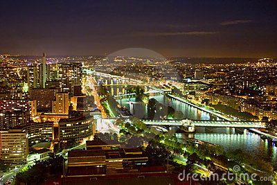 Paris with Seine River at night