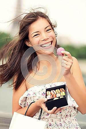 Paris woman eating french macaron