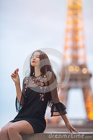 Free Paris Woman Smiling Eating The French Pastry Macaron In Paris Against Eiffel Tower. Stock Photo - 112195980